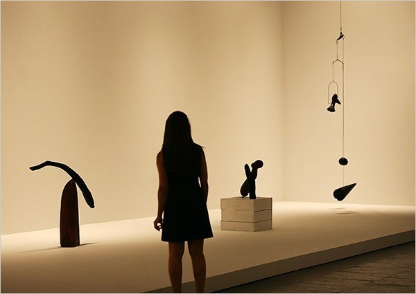 """[Photo: Librado Romero/The New York Times] An installation view of """"Alexander Calder: The Paris Years"""" at the Whitney Museum. Holland Cotter writes: Is art basically glorified child's play, extending into adulthood, through a lifetime, picking up ideas and gaining finesse as it goes? That's one way to think of """"Alexander Calder: The Paris Years, 1926-1933"""" at the Whitney Museum of American Art."""
