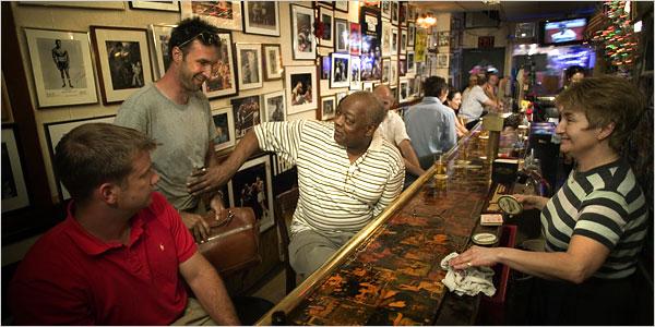 [Piotr Redlinski for The New York Times]Jimmy Glenn, center, in his bar, Jimmy's Corner, on 44th Street.