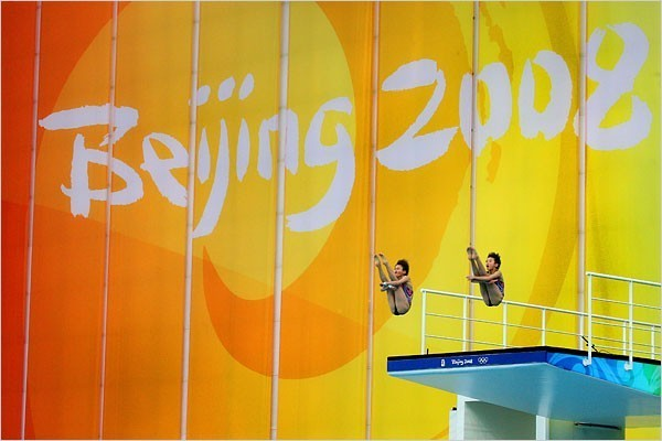 [Photo: Doug Mills/The New York Times] Roulin Chen, left, and Xin Wang of China winning the gold in 10-meter synchronized diving.