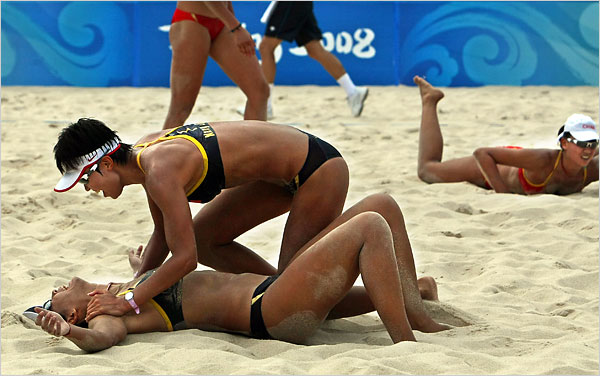 [Photo: Thomas Coex/Agence France-Presse — Getty Images]China's Wang Jie, on ground, and Tian Jia after winning their women's semifinal beach volleyball match.They defeated fellow countrywomen Xue Chen and Zhang Xi to advance to the gold medal final against the Americans Misty May-Treanor and Kerri Walsh.