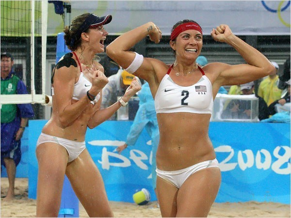 [Photo: Doug Mills/The New York Times] Kerri Walsh, left, and Misty May-Treanor won the gold medal in women's beach volleyball, beating the Chinese team of Tian Jia and Wang Jie by 21-18, 21-18.