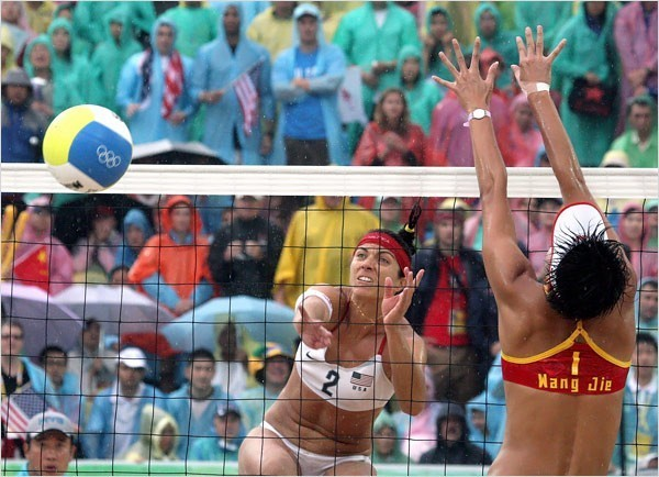 [Photo: Doug Mills/The New York Times] The U.S. team did not drop a set during the Games. Left, Wang Jie of China and May-Treanor.