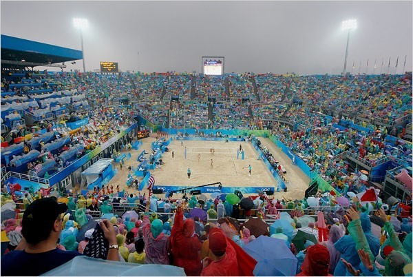 [Photo: Jamie Squire/Getty Images] It rained throughout the match, and the spectators in the sell-out crowd wore pastel-colored plastic ponchos.
