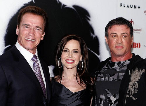 """[AP/Isaac Brekken]'Rambo' premiereCalifornia Gov. Arnold Schwarzenegger, from left, Julie Benz and Sylvester Stallone arrive at the """"Rambo"""" premiere at Planet Hollywood Hotel & Casino in Las Vegas on Jan. 24."""