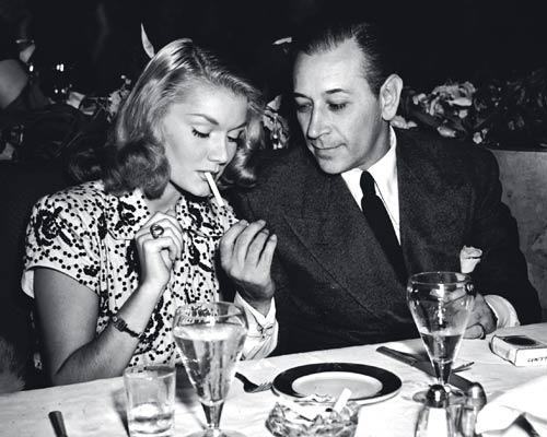 [CIRO'S] Actress Eve Amber and screen star George Raft at Ciro's in 1945.