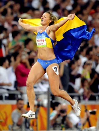 [Wally Skalij/Los Angeles Times] 2008 Beijing Games Day 8 Ukraine's Natalia Dobrynska celebrates her gold medal in the women's heptathlon at the 2008 Beijing Olympics.
