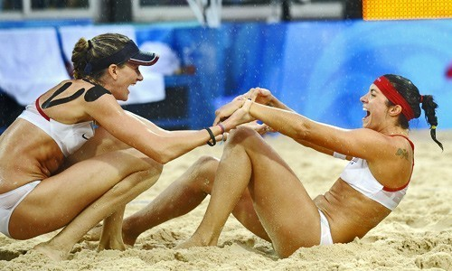 [Wally Skalij/Los Angeles Times] Kerri Walsh, left, and Misty May-Treanor celebrate their gold medal over China at the 2008 Beijing Olympics on Thursday.