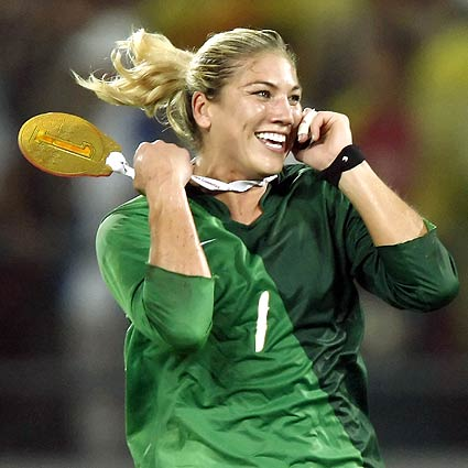 [Robert Gauthier/Los Angeles Times] 2008 Beijing Games Day 13 U.S. goalie Hope Solo runs across the field sporting a homemade gold medal while talking on a cellphone during a post-game celebration.