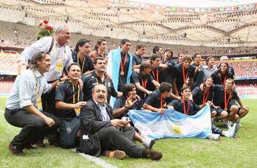 [Photo credit: Mark Dadswell/Getty Images] The Argentinian team celebrates.