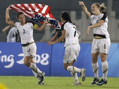 [Associated Press] Christie Rampone, left, Shannon Boxx, center, and Amy Rodriguez celebrate after beating Brazil.