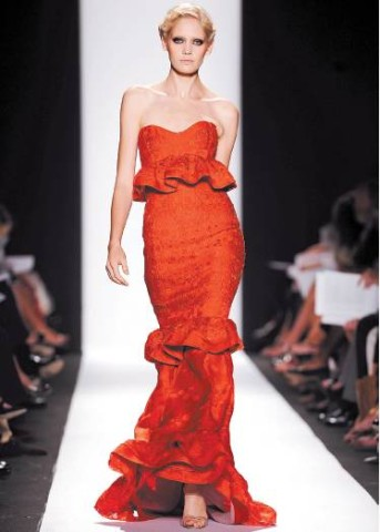 [RICHARD DREW/AP] RED THREAD Carolina Herrera's Spring 2009 collection at Mercedes-Benz Fashion Week featured a range of colorful evening gowns.