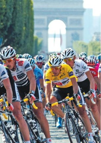 [J O E L S A G E T/A F P/ G E T T Y]TOUR WINNER Wearing the yellow jersey, Carlos Sastre rides down the Champs-Elysees in Paris yesterday.