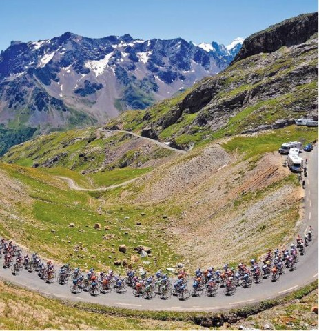 [PATRICK HERTZOG/AFP/GETTY]ALPINE CLIMB The pack rides at the Col du Galibier yesterday during the 17th stage of the Tour de France.