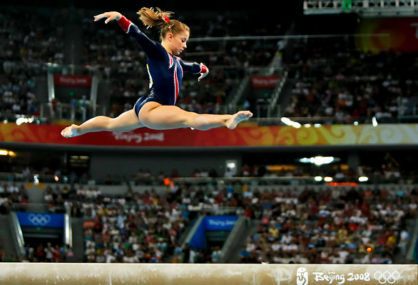 [Robert GauthierLos Angeles Times]Johnson performs the balance beam routine that earned her a gold medal.