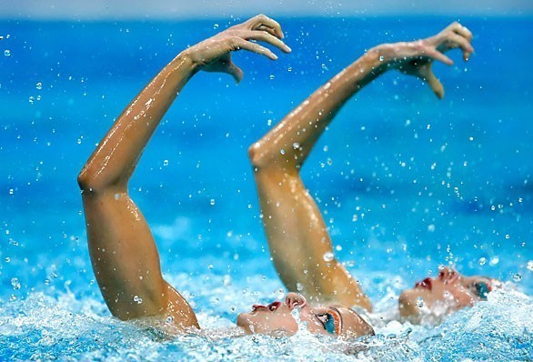 [Robert Gauthier Los Angeles Times] 2008 Beijing Games Day 12 Russian duet Anastasia Davydova, left, and Anastasia Ermakova mirror each other in the synchronized swimming free final. They clinch the gold.