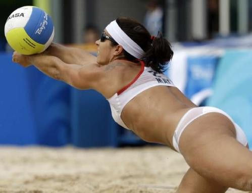 [Credit: Natacha Pisarenko /Associated Press] Misty May-Treanor lunges for the ball during the match against Cuba's Tamara Larrea and Dalixia Fernandez Grasset.