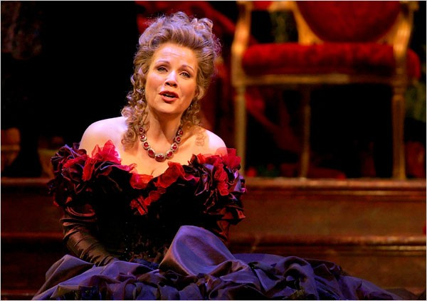 """[Photo: Ruby Washington/The New York Times] The Metropolitan Opera commissioned three renowned fashion designers to create Renée Fleming's costumes for its season opener, a gala showcase in which Ms. Fleming was featured in roles from three different operas. Ms. Fleming in """"Traviata,"""" in another gown by Mr. Lacroix."""